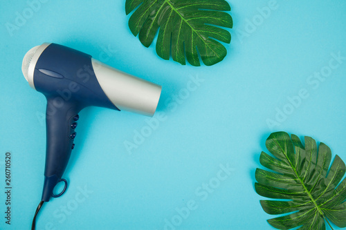 Photo Blue hair dryer on blue creative background