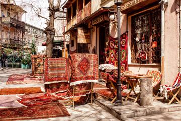 Fototapeta na wymiar Sale of national carpets on the streets of Tbilisi. Georgia.