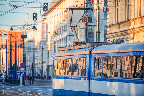 Fototapeta 17/02/2019 Krakow, Poland, the city's blue trams are moving in the center of the old city obraz