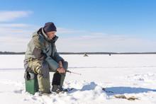 Fisherman Fishing Winter Fishing On A Bright Sunny Day