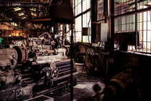 Old Steel Factory. Retro Photography. Old Factory Industry. Photography. Metal Pipes. Dark Interior Of Large Halls For Production Or Warehouses.soft Focus.