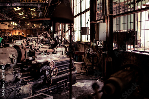 Photo sur Toile Les vieux bâtiments abandonnés Old steel factory. Retro photography. Old factory industry. Photography. Metal pipes. Dark interior of large halls for production or warehouses.soft focus.