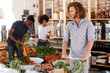 Shoppers Buying Fresh Fruit And Vegetables In Sustainable Plastic Free Grocery Store
