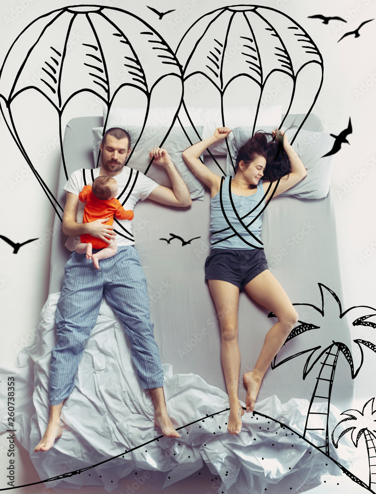 Fototapety, obrazy: Extremal activity for family. Top view photo of young couple and child sleeping in a big white bed. Dreams concept. Painted dream about sport, hobby, emotions, flight, skydiving, beach and summer.