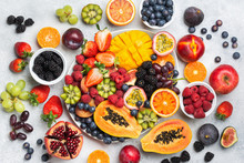 Healthy Raw Rainbow Fruit Platter Mango Papaya Strawberries Oranges Passion Fruits Berries On Oval Serving Plate On Light Concrete Background, Top View, Selective Focus
