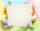 Easter background; Easter Eggs with spring Flowers on colorful Background - 260742380