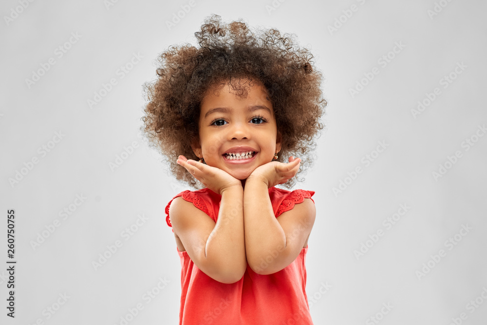 Fototapety, obrazy: childhood and people concept - happy little african american girl over grey background