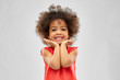 Leinwanddruck Bild - childhood and people concept - happy little african american girl over grey background