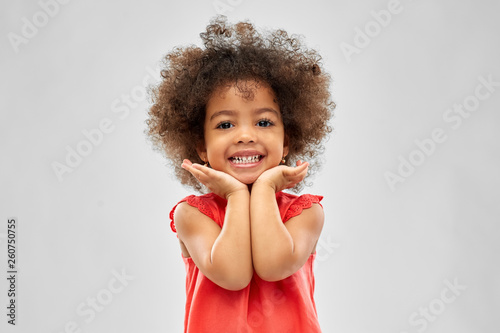 Photo childhood and people concept - happy little african american girl over grey back