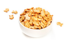 Salty Goldfish Crackers In A Bowl On A White Background With A Place For Text