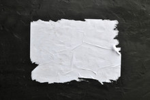 White Sheet Of Paper On A Black Background.