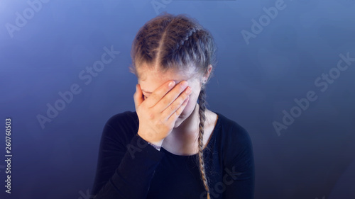 Fotografía  Teenage girl with pigtails, being attacked by social media, creating emotional s