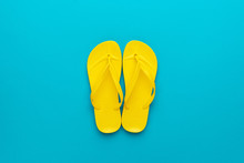 Yellow Beach Flip-flops On The...