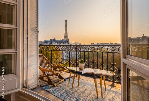 beautiful paris balcony at sunset with eiffel tower view  - 260794563