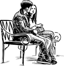 A Couple Of Young Townspeople Sitting On A Park Bench