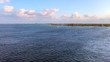 Pan across Grand Cayman Island from a ship on the ocean
