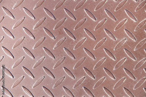 Fotografiet  Decorative brown metal surface with ornaments