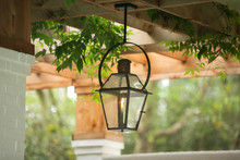 Upscale Luxury Outdoor Hanging Patio Classic Lantern  Lighting With A Burning Flame With Curb Appeal