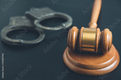 Fotografia, Obraz  judge with handcuffs on the desk