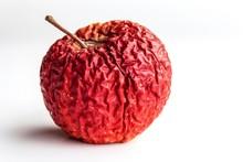 Wrinkled Apple Texture With White Background. Shriveled Apple. Old Apple.