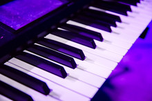 Piano Keys Close Up In Purple Concert Light