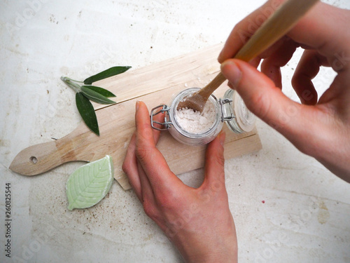 Photo  Caucasian woman making homemade vegan deodorant in a glass jar and adhering to a