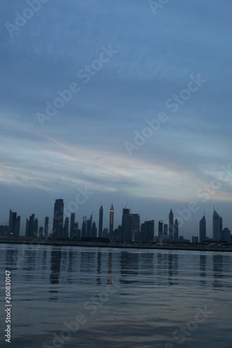 Spoed Foto op Canvas Dubai Dubai Skyline under Cloudy Sky, Dubai Downtown Residential and Business Skyscrapers, a view from Dubai Water Canal, Dubai, United Arab Emirates