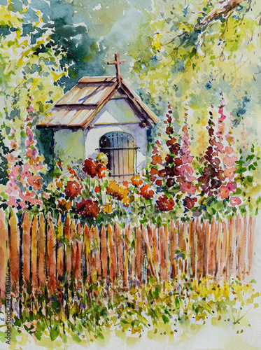 Small white Chapel behind the fence among summer flowers Fototapet