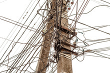 A Telegraph Pole With Many Wires And Communication Lines