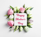 Beautiful Eustoma flowers and card on light background