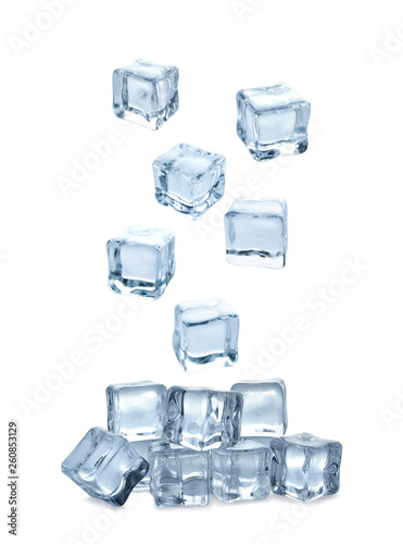 Set of flying crystal clear ice cubes on white background