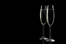 Glasses Of Champagne On Black Background, Space For Text