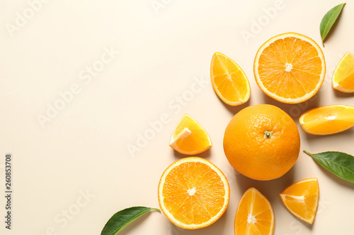Stampa su Tela Flat lay composition with ripe oranges and space for text on color background