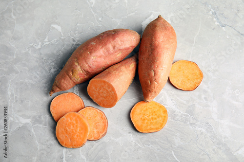 Flat lay composition with sweet potatoes on grey background