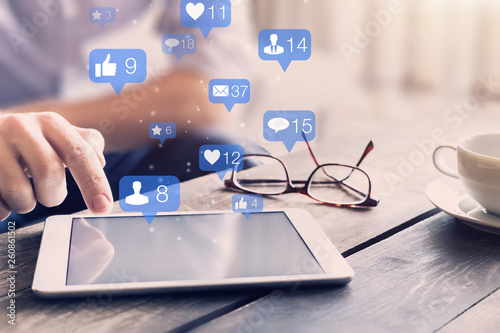 Obraz Social media network interactions concept with icons of comments, friend contact requests and messages showing engagement from users and digital marketing on mobile devices, person touching screen - fototapety do salonu