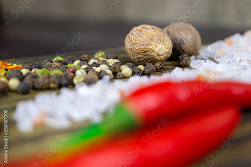 Fotografia  Oriental spices on the cutting Board, bright and spicy pepper.