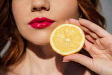 Cropped View Of Redhead Girl With Red Lips Posing With Lemon