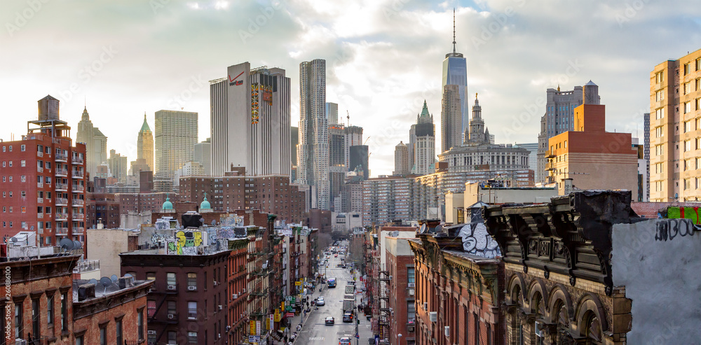 Fototapety, obrazy: New York City - Panoramic view of the crowded buildings of the Manhattan skyline at sunset.