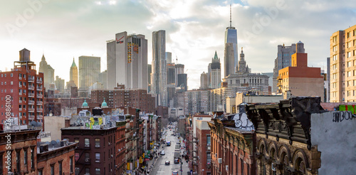 New York City - Panoramic view of the crowded buildings of the Manhattan skyline at sunset. - 260886100