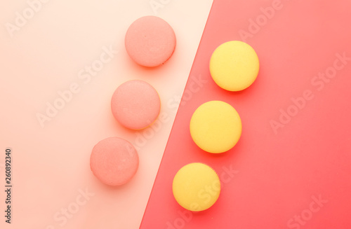 Spoed Foto op Canvas Macarons Pink yellow macaroons on total pink background with place for text, minimalism style, top view
