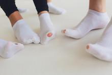 Hole In Gray Sock Shows Big Female Toe.
