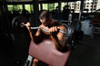 Athlete Working Out Biceps In A Gym