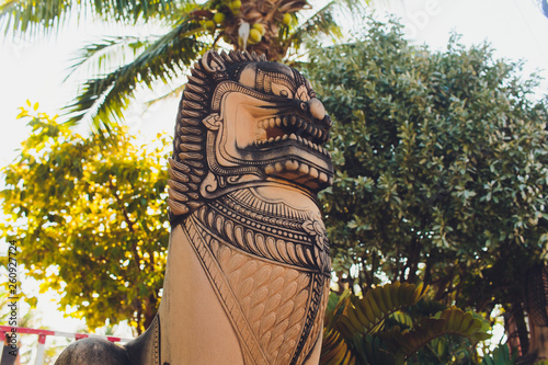 Fotografia  The lion statue in a buddhist temple in Phuket, Thailand.