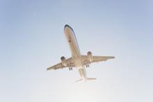 Airplane Flying Under Blue Sky...