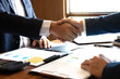 Finishing up a discussion on meeting after collaboration, handshake of two business people after contract agreement to congratulation become a partner, collaborative teamwork