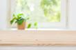 Plain wooden texture table on defocused summer window background