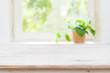 Light wooden texture table before defocused summer window background
