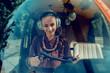 Leinwanddruck Bild - Joyful appealing woman wearing special headphones while being helicopter pilot