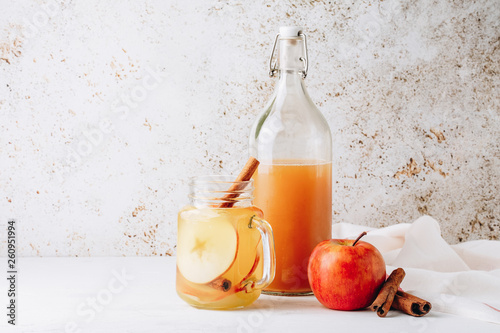 Cool, healthy drink with apple cider vinegar, honey, apples and cinnamon Fototapeta