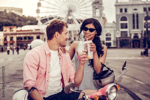 Fotografie, Obraz  Joyful positive couple cheering with their drinks